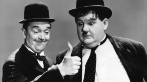Stan Laurel and Oliver Hardy, one of Hollywood's most peculiar (and successful) comedy teams.  From the 1937 movie Way Out West (source:  TimeOut.com)
