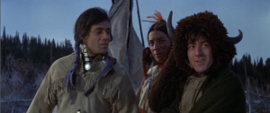 In the 1970 film Little Big Man, Jack Crabb/Little Big Man (Dustin Hoffman) and Younger Bear (Cal Bellini) discuss their marriages as Little Horse (Robert Little Star) looks on.  (Photo from http://limereviews.blogspot.com/)