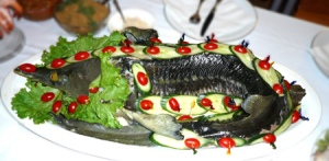Sturgeon in Aspic, a traditional Russian method of preparing this Caspian Sea fish.  A sturgeon like this one prompted the reaction that so embarrassed Sergei Kapitonich Ahineev that he resorted to slander in a vain attempt to preserve his reputation.  (Photo:  Cuisine by Andrei)