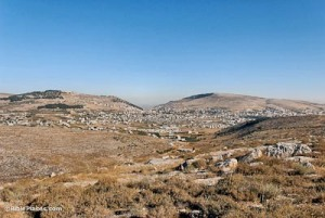 View of Shechem (Nablus) from the east. The city is between Mount Gerazim (left), the Mount of Blessing, and Mount Ebal (right), the Mount of Cursing. (Photo: BiblePlaces.com)