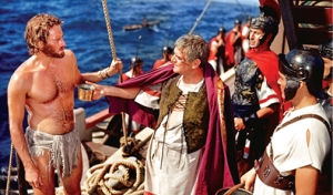 "Quintus Arrius (Jack Hawkens) offers water to Judah Ben Hur (Charlton Heston) in the 1959 epic, Ben Hur. (Photo: Warner Home Video, featured in ""A Day at the Chariot Races: The Digital Liberation of 'Ben-Hur'"", by Bill Desowitz, Motion Picture Editors Guild, November 21, 2011)"