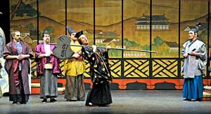 The arrival of Ko-Ko, Lord High Executioner of Titipu. From the 2008 production of The Mikado by the Seattle Gilbert & Sullivan Society.