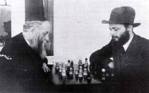 The 6th Lubavitcher Rebbe, left, playing chess with his younger son-in-law, the future 7th Rebbe, right, allegedly on Nittel Nacht.