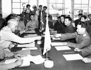 Major General Blackshear M. Bryan, left, exchanges credentials with North Korean Lt. General Lee Sang Cho at the opening session of the military armistice commission at the Panmunjom conference house July 28, 1953.  (AP Photo)