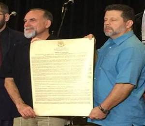 B'ney Yosef North America Articles of Declaration presented by Elder Barry Phillips (r) and Executive Director Albert McCarn (l) upon affirmation on March 5, 2016.