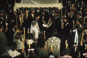 My first encounter with a chuppa was watching Norman Jewison's 1971 film adaptation of Fiddler on the Roof. I did not understand at the time the significance of the canopy over the bride and groom. (© 1971 Metro-Goldwyn-Mayer Studios Inc. All Rights Reserved.)