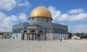 Dome of the Rock. Notice the tourist at left wearing the white skirt.