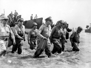 "General Douglas MacArthur wades ashore on Leyte, Philippine Islands, in October 1944 to keep his promised, ""I shall return""."